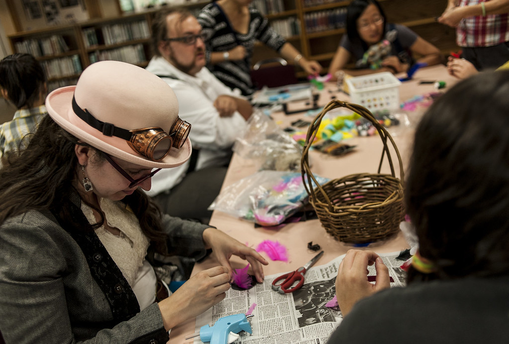 d45cf91b5b ... Taryn Lentes makes a miniature top hat at the Athens Public Library,  part of the