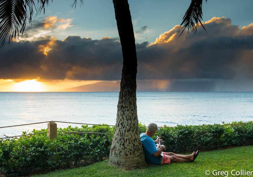 Greg playing new uke in Maui.jpg