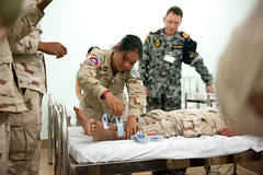 Royal Australian Navy Lt. Craig Blackburn guides Cambodian medical personnel on the proper placement of electrocardiogram sensors during a June 23 professional nursing exchange. (U.S. Navy/MCC Greg Badger)