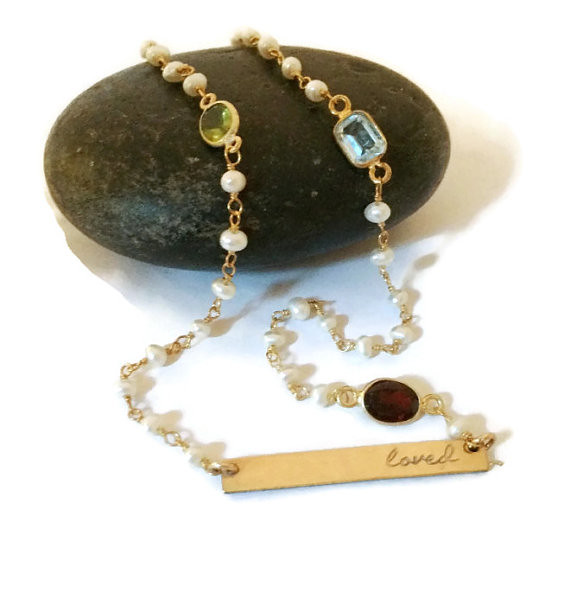 gold gemstone pearl necklace tag