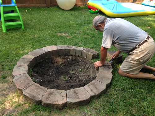 Grandpa Working on Firepit