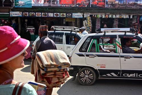 Kathmandu vendor working his way through Kathmandu traffic