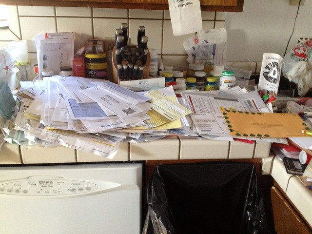Kitchen counter covered in junk mail