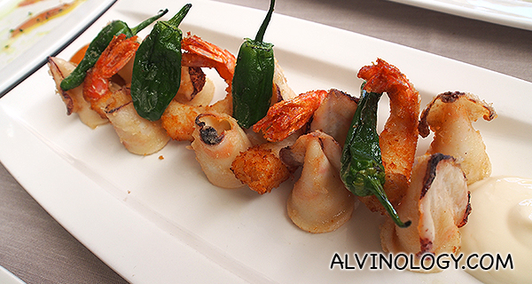 Fry of king prawns and small squids with romesco sauce and alioli