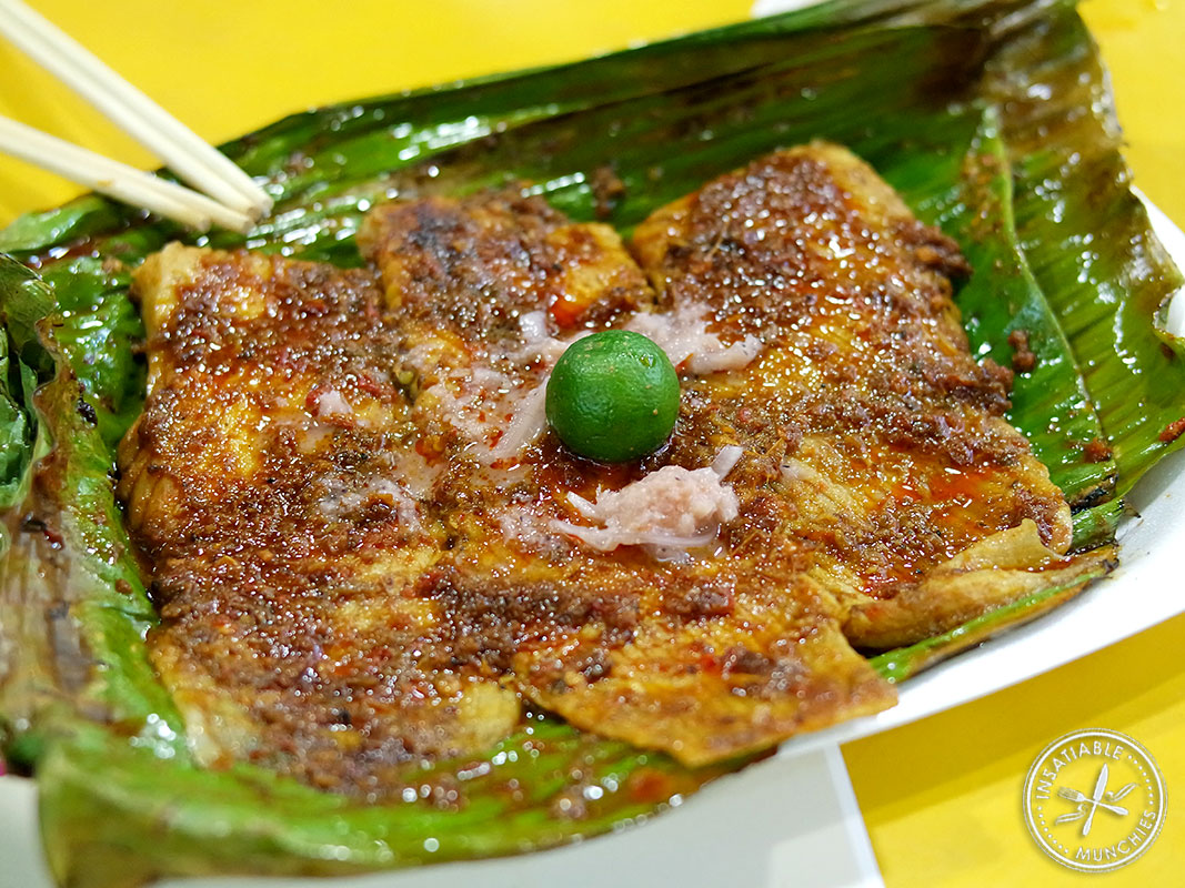 Fins of a sting ray is covered in samba and barbecued in banana leaves. It's finished off with lime and chinchalok - a mixture of shrimp and pickled eshallots.