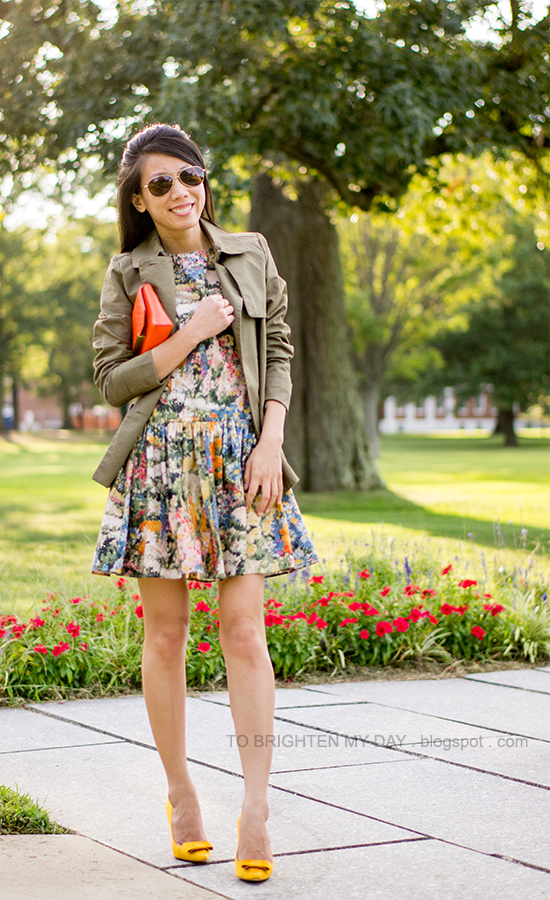 sage green swing trench, printed wildflowers dress, orange clutch, mustard yellow bow pumps