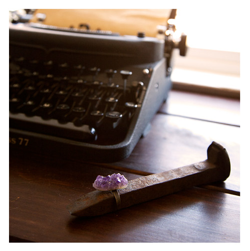 Moorea Seal Amethyst Ring on a Railroad Tie with Vintage Typewriter
