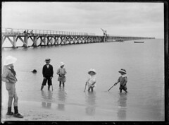 Children paddling at the beach, 1915
