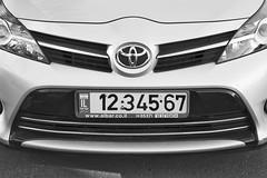 automobile(1.0), automotive exterior(1.0), toyota(1.0), vehicle(1.0), automotive design(1.0), toyota vitz(1.0), grille(1.0), bumper(1.0), land vehicle(1.0), vehicle registration plate(1.0),