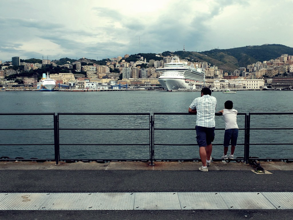 Father and son watching the cruise ship