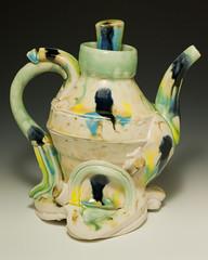 jug(0.0), drinkware(0.0), saucer(0.0), vase(0.0), art(1.0), serveware(1.0), yellow(1.0), pottery(1.0), tableware(1.0), ceramic(1.0), teapot(1.0), porcelain(1.0),