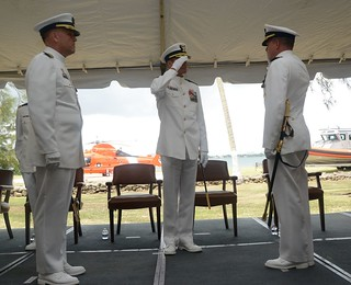 Capt. Robert W. Warren (right), Sector San Juan commander, assumes command of Sector San Juan as he salutes Rear Adm. Jake H. Korn, commander of the Coast Guard's Seventh District, while Capt. Drew W. Pearson (left), U.S. Coast Guard retired, relinquished command of the unit during a ceremony July 15, 2014 at Coast Guard Sector San Juan.  In his role as Sector Commander, Capt. Warren will lead approximately 650 active duty, reserve and civilian men and women to conduct all Coast Guard missions in the Eastern Caribbean including Puerto Rico and the U.S. Virgin Islands. (Photo by Ricardo Castrodad, Sector San Juan public affairs specialist)