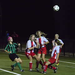 Kinley going for the header...