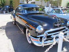 buick roadmaster(0.0), buick super(0.0), automobile(1.0), automotive exterior(1.0), pontiac chieftain(1.0), vehicle(1.0), hot rod(1.0), antique car(1.0), sedan(1.0), vintage car(1.0), land vehicle(1.0), luxury vehicle(1.0), motor vehicle(1.0),