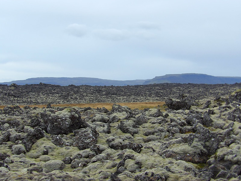 Lava field and mountains beyond
