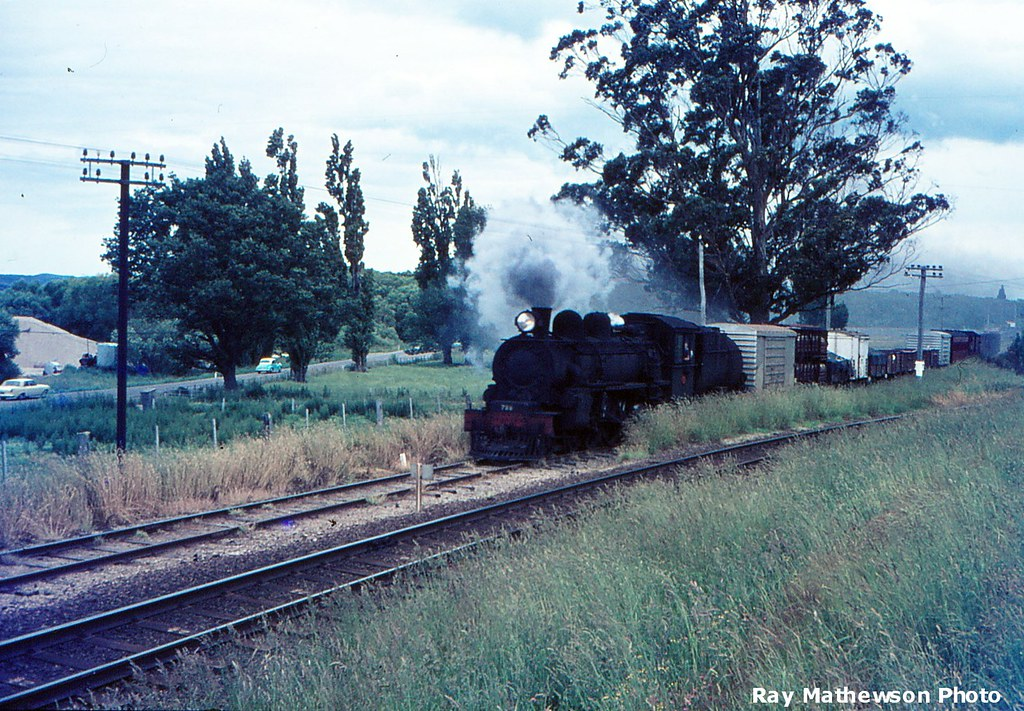 Train from Tahakopa approaching Balclutha. SIMT in the foreground. Late 1960's.