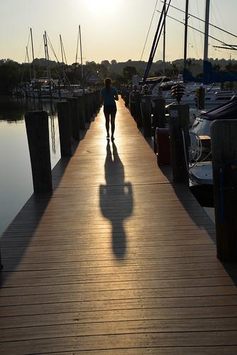 sunset shadow silhouette marina pier boardwalk rissa herringtonharbor