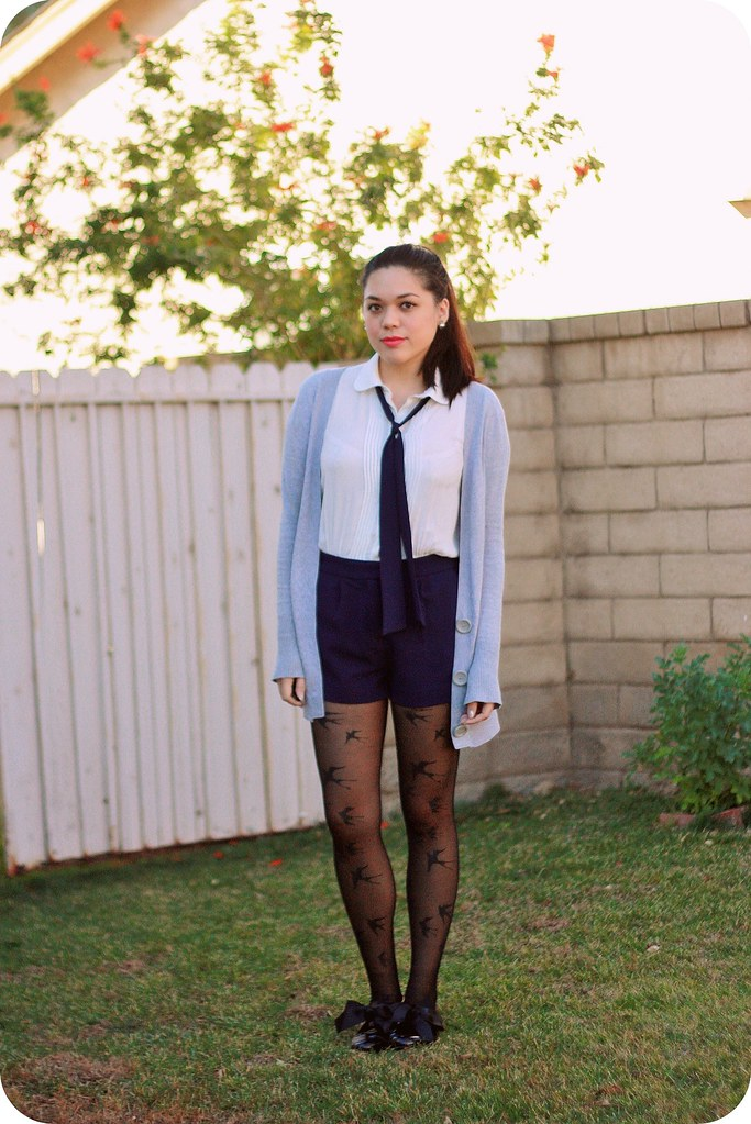 Outfit style post: white and navy short-sleeve tie-neck romper, gray boyfriend cardigan, bird print tights, black patent jazz oxford flats