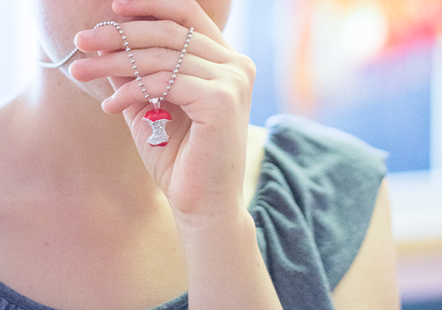 silver and red apple core necklace