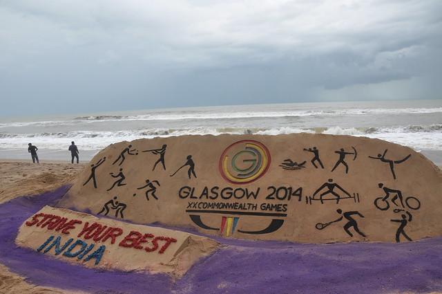 Sri Manas Kumar Sahoo created a sand sculpture at Puri sea-beach encourage Indian Team Common Wealth Games.
