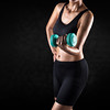 Athletic woman lifting dumbbell