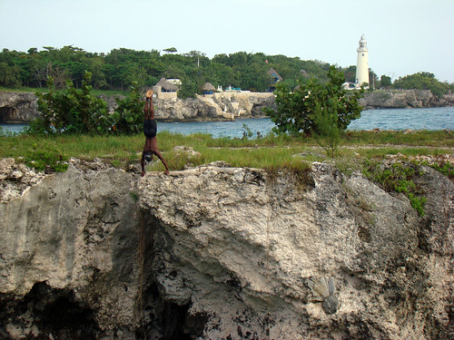 A diver getting ready to jump, with the Negril Lighthouse behind - Aug. 15th