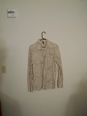 brown(0.0), design(0.0), drawing(0.0), sweater(0.0), t-shirt(0.0), art(1.0), textile(1.0), clothing(1.0), sleeve(1.0), outerwear(1.0), cardigan(1.0),