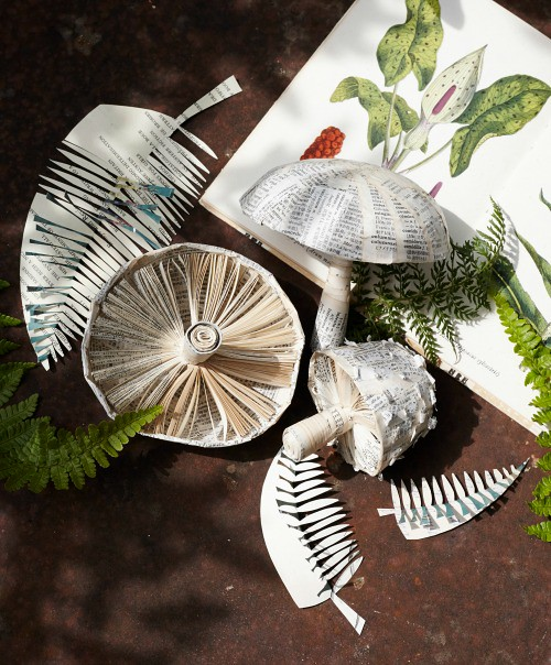 book page paper sculpture of mushrooms and ferns