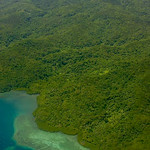 Aerial photo of Kadavu Island, Fiji showing extensive lowland rainforest extending to coastal coral reef.