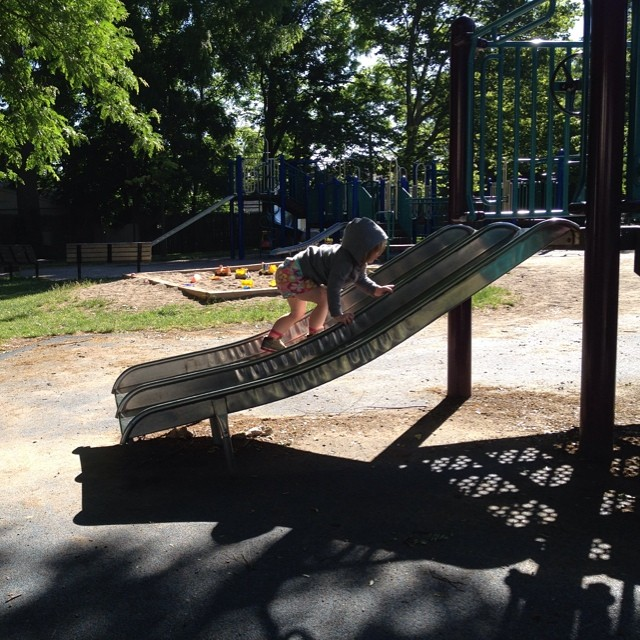 Climbing the slide. We have the whole playground to ourselves!