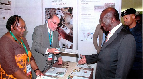 Vice president of Uganda Hon. Edward Ssekandi, right being handed ILRI's brochure by ILRI's Emily Ouma and Danilo Pezo at the ILRI exhibit
