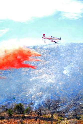 A Single Engine Airtanker, or SEAT, flies over a wildland fire dropping retardant to help extinguish the flames. The U.S. Forest Service served as subject matter experts to help Disney animators provide a sense of reality to the move Planes: Fire and Rescue. (Inciweb.nwcg.gov)