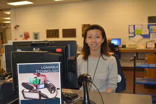 One of our student workers at the Loanable Technology Desk. Photo Courtesy of Janelle Sander.