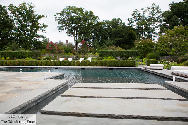 Outdoor pool with a tennis court in the back