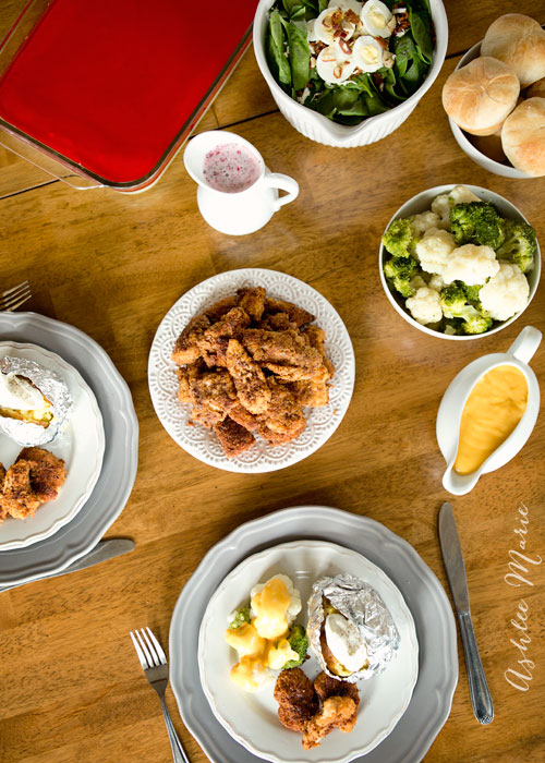 breaded chicken salad, potatoes rolls and more make this a complete dinner
