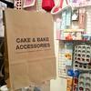 Grabbing some toys at @pastry_boy's shop Cake & Bake, 5 rue de Lancry.