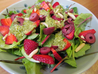 Strawberry Field Greens with Black Olives and Toasted Pine Nuts