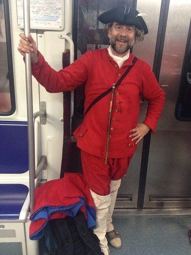 A red Miquelet reenactor in the metro