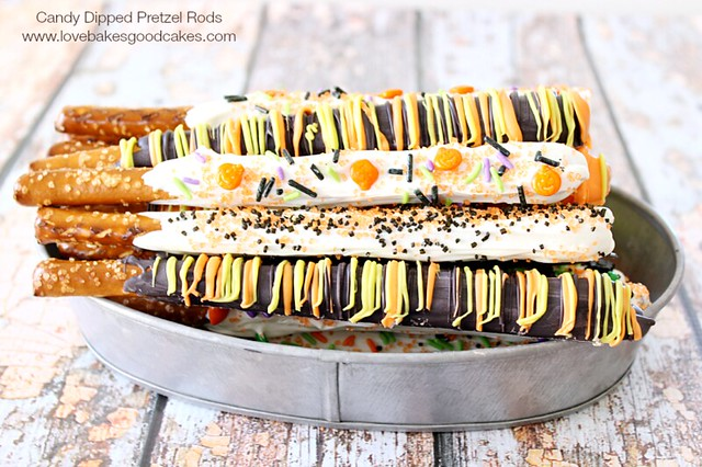 Candy Dipped Pretzel Rods laying on a metal pan.