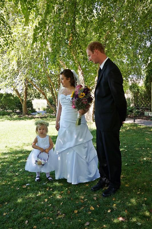 bride, groom, and flower girl