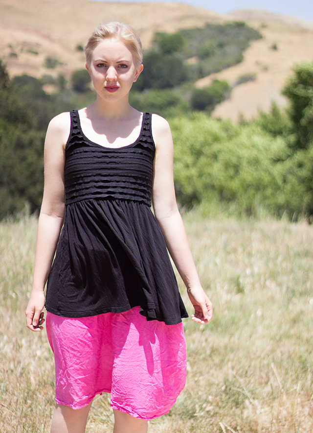 ruffled black tank-top, pink skirt, California's golden hills