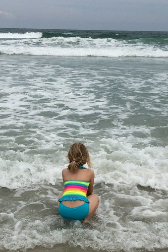 waiting for the waves to come to her