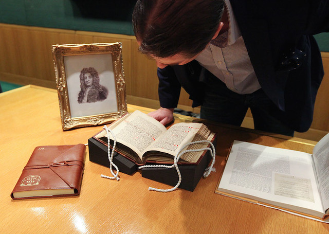 Phillip Duff examines the original 1495 volume under the watchful eye of Sir Hans Sloane