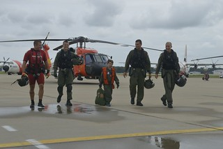 Isaac Simmons, a Make-A-Wish recipient, is shown here, Aug. 23, 2014, at Coast Guard Air Station Elizabeth City, N.C., walking besides the crew he just flew with.  Isaac Simmons made a wish to be a Coast Guard rescue pilot and the crew of Coast Guard Air Station Elizabeth City helped to make it happen.  (U.S. Coast Guard photo by Petty Officer 3rd Class David Weydert)