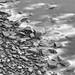 The Seas Washing over Rocks