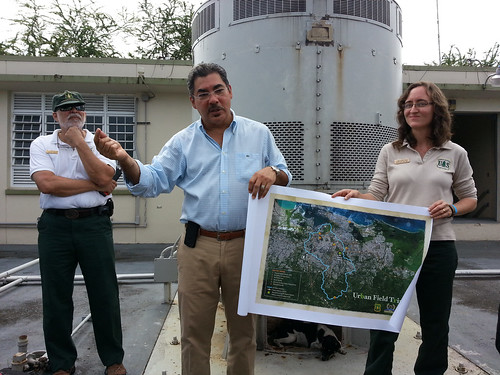 U.S. Forest Service International Institute of Tropical Forestry Director Ariel E. Lugo (left) and Research Ecologist Tamara Heartsill Scalley (right), along with José Seguinot (center), director of the Environmental Health Department at the University of Puerto Rico, discuss the potential vulnerabilities of urban areas to floods and the role of urban hydrology at the Baldorioty de Castro storm water pump station in San Juan, Puerto Rico, the first stop of an urban field trip on May 20 held as part of the International Institute of Tropical Forestry's 75th anniversary celebration. (U.S. Forest Service)