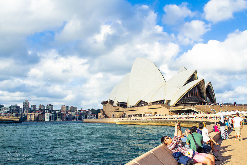 Tourists spending time near the Sydney Opera House