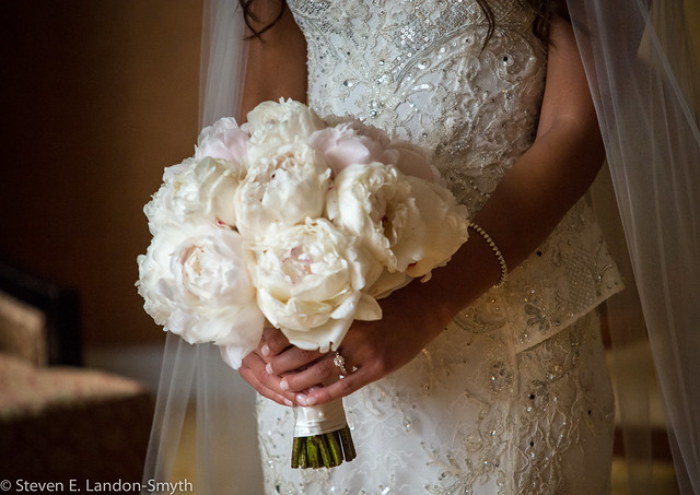 Bride holding bouquet in beautiful natural light