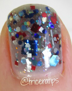 Weird out-of-focus thumb macro, but look at the large blue square glitter!!