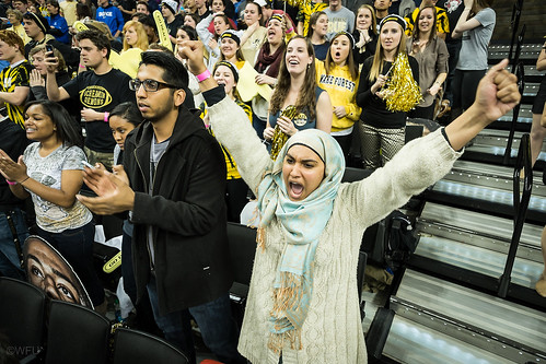 A fan cheers on the Demon Deacons